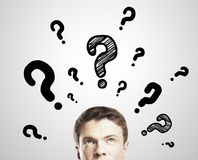 Man with questions Stock Images