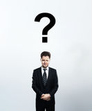 Man with questions symbol Royalty Free Stock Images