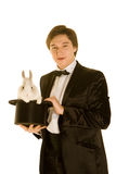 Man with a rabbit in a hat. Man with a rabbit in a silk top hat Royalty Free Stock Image