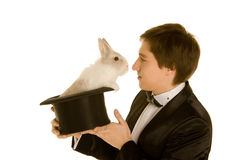 Man with a rabbit in a hat. Man with a rabbit in a silk top hat Royalty Free Stock Photos
