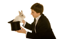 Man with a rabbit in hat. Man with a rabbit in a silk top hat Stock Images
