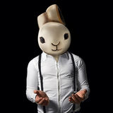 Man rabbit. Man with rabbit head and hands outstretched Royalty Free Stock Image
