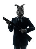 Man with rabbit mask shotgun silhouette. One causasian man rabbit mask hunting with shotgun portrait in silhouette studio isolated on white background Royalty Free Stock Photography