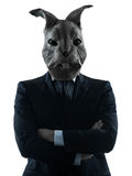 Man with rabbit mask silhouette portrait. One causasian man rabbit mask  portrait in silhouette studio isolated on white background Stock Image