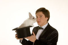 Man with a rabbit in a silk top hat. On white background Royalty Free Stock Photography