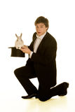 Man with a rabbit in a silk top hat Royalty Free Stock Photos