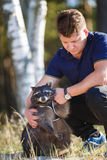 Man with raccoon Royalty Free Stock Image