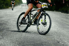 Man racer cyclist mountainbiker downhill on gravel road Royalty Free Stock Image