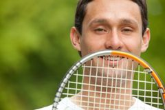 Man and a racket Royalty Free Stock Photo