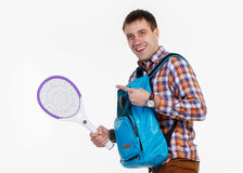 Man with a racket against mosquitoes Stock Image