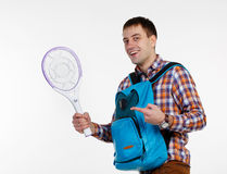 Man with a racket against mosquitoes Stock Images