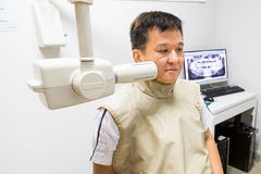 Man with radiation protection vest receiving dental  X-Ray at a dentist Stock Photography