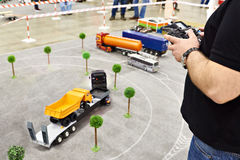 Man with radio remote control and truck model Royalty Free Stock Image