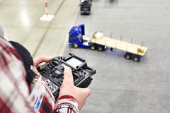Man with radio remote control and truck model Royalty Free Stock Photos
