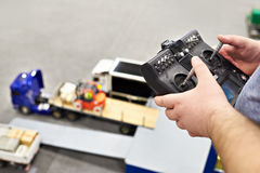 Man with radio remote control and truck model Royalty Free Stock Images
