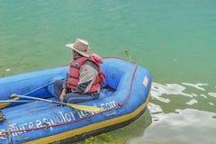 Man at Raft Boat, Quilotoa, Ecuador Stock Images