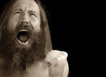 Man With Rage. Dramatic portrait of a Bearded man Very Upset Royalty Free Stock Photography