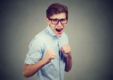 Man in rage threatening to punch someone with fists Royalty Free Stock Photos