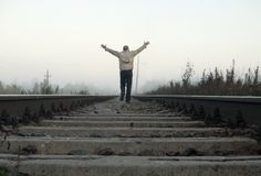 Man on railway tracks. Is gesticulating Royalty Free Stock Images