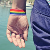 Man with a rainbow flag painted in his wrist Stock Photography