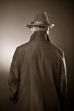 The man in a raincoat and a hat Royalty Free Stock Photography
