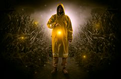 Man coming out from a thicket with lantern Stock Photos