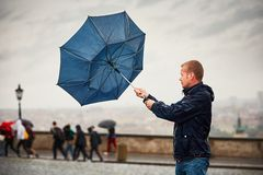 Man in rainy day Stock Images