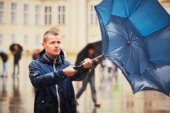 Man in rainy day Stock Image
