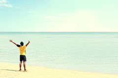Man raised arm on the beach Royalty Free Stock Images