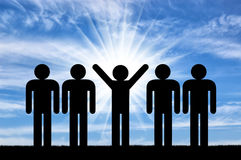Man with raised arms among ordinary people Royalty Free Stock Photos