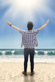 Man raised hands at the beach Stock Photography