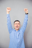 Man raised hands up. Making victory gesture Stock Photos