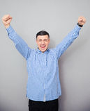 Man raised hands up. Making victory gesture Stock Images