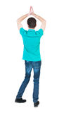 A man raised his hands in prayer. Royalty Free Stock Photography