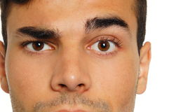 Man with a raised one eyebrow. Face close-up of young man with a raised one eyebrow Stock Photo