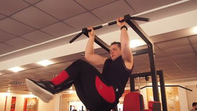 The man raises the bar in the sports foot. Lifting the legs to the side. stock video