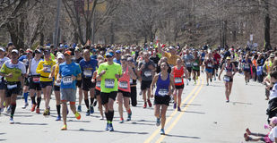 Man raises fist in triumph at Boston Marathon 2014 Royalty Free Stock Image