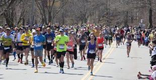 Man raises fist in triumph at Boston Marathon 2014 Royalty Free Stock Image