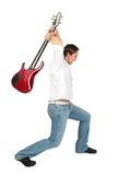 Man raises guitar,  want crash. Royalty Free Stock Photography