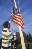 Man Raising American Flag Stock Photography
