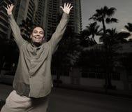 Man raising arms Stock Images
