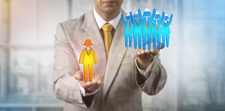 Man Raising Blue Collar Team Above Female Manager. Unrecognizable negotiator raising a group of five blue collar workers over a female white collar manager royalty free stock images
