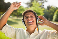 Man raising his arms while using headphones to sing along to mus Royalty Free Stock Photos
