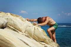 Man Raising His Hands or Open arms standing back looking to sea blue sky horizont. Royalty Free Stock Image