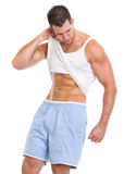 Man raising shirt to show abdominal muscles Stock Images