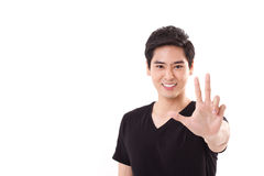 Man raising, showing 3 fingers hand sign gesture with thumb Royalty Free Stock Photography