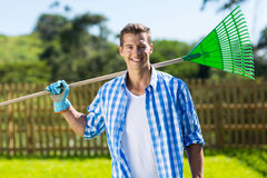 Man rake garden Royalty Free Stock Images