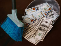 Man rakes in the money in savok. Sweep of the banknote in the trash. Clean money in the trash. Man rakes in the money in savok. Sweep of the banknote in the Royalty Free Stock Image