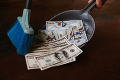 Man rakes in the money in savok. Sweep of the banknote in the trash. Clean money in the trash. Man rakes in the money in savok. Sweep of the banknote in the Stock Photo
