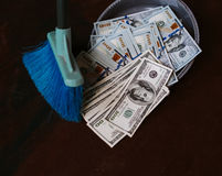 Man rakes in the money in savok. Sweep of the banknote in the trash. Clean money in the trash. Man rakes in the money in savok. Sweep of the banknote in the Stock Photography